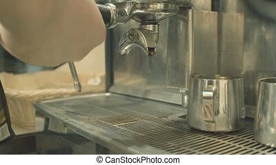 Espresso machine brews coffee - Barista brews a fresh drink...