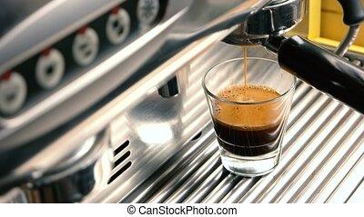 Espresso machine filling a glass.