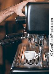 Espresso machine making coffee, golden espresso flowing. Coffee espresso