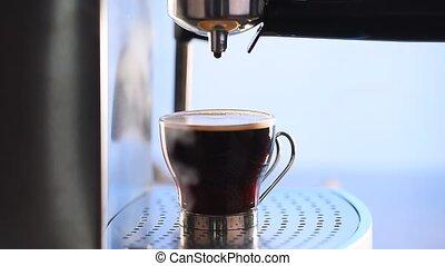Espresso - Modern glass cup of black coffee brewing via a...