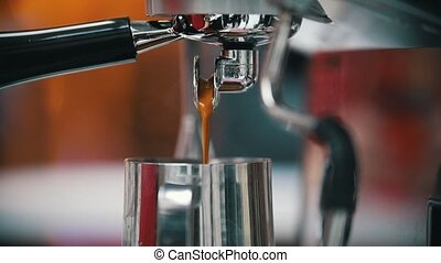 Espresso pouring from coffee machine. Middle roasted. Close...