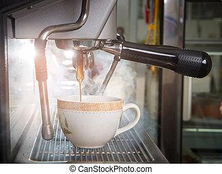 Espresso shot coffee machine with filter make coffee flowing into a cup. hot coffee flowing to coffee cup.