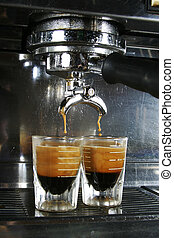 Espresso Shot - Espresso being drawn out of a professional...