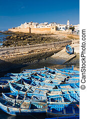 Fishermans boats in Essaouira, city in the western Morocco, on the Atlantic coast. It has also been known by its Portuguese name of Mogador. Morocco, north Africa.