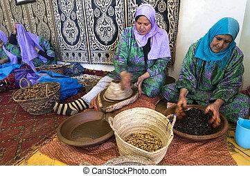 ESSAOUIRA, MOROCCO-FEBRUARY, 7: women working in a...