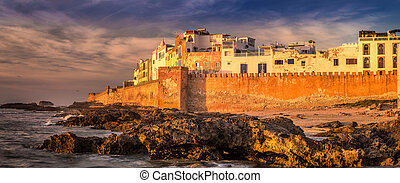 Essaouira old city walls in Morocco. Shot at sunset.