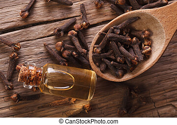 essence of cloves in the bottle  horizontal top view