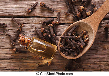 essence of cloves in the bottle macro  horizontal top view