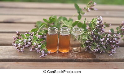 Essence of lavender flowers on table in beautiful glass...