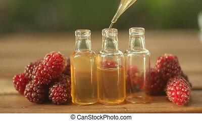 Essence of Wild raspberries on table in beautiful glass...