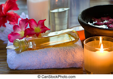 Arrange one of the essence oil above the towel used for reflexology in spa.