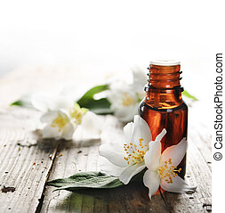 Essential Oil - Essential oil with jasmine flower on wooden ...