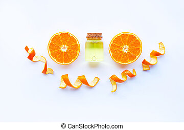 Essential oil of orange on white.