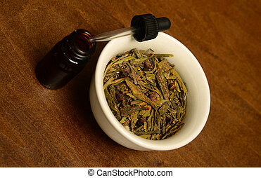 essential oil with scented herbs for aromatherapy