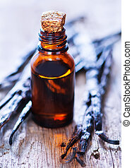Essential oil with vanilla on a table