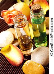 Essential oils bottles - spa essences with massage stones...