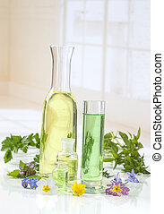 essential oils for aromatherapy treatment with fresh herbs