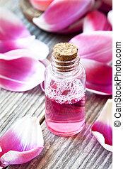 essentie, fles, met, zacht, roze, kroonbladen