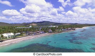 Establishing a beautiful beach resort in aerial - A...