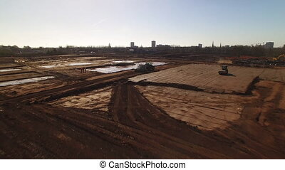 Establishing aerial shot of a construction site - An...