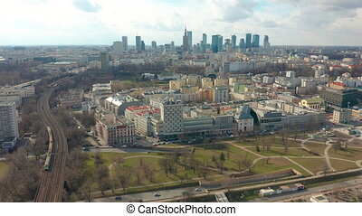 Establishing aerial shot of Warsaw downtown in the evening,...