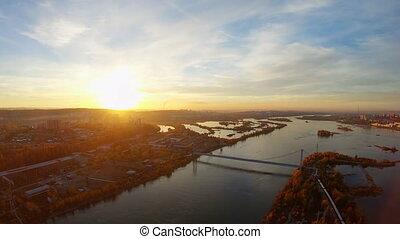Establishing aerial view of Irkutsk city at sunset in autumn. Angara river from birds eye view. 4K