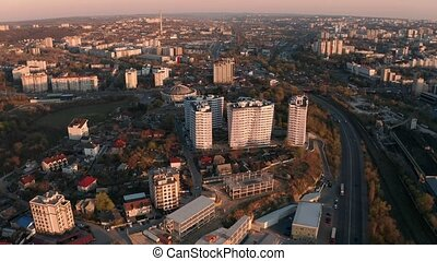 Establishing orbiting aerial shot of Circus area of Chisinau, capital city of Moldova, Eastern Europe in warm rays of sunset