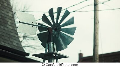 Establishing shot a handcrafted windmill in the front yard...