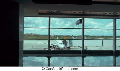 Establishing shot of a fully boarded airplane as viewed...