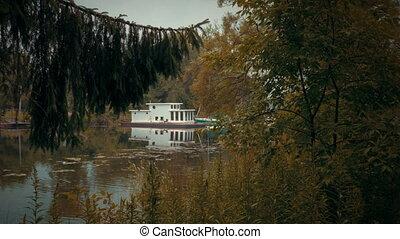 Establishing shot of a houseboat in 4K - 4k UHD wide shot of...