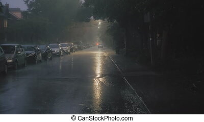 Establishing shot of a ity street at night during a storm. -...