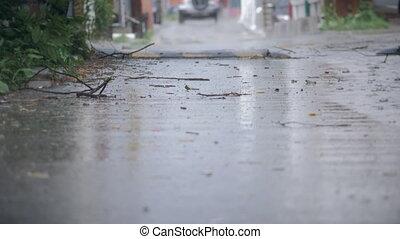 Establishing shot of an alleyway during a hard rain. 4K.