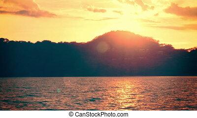 Establishing shot of an island at sunset. - 4K footage of an...