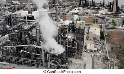 Establishing shot of an oil, petroleum, gas refinery. Cinematic 4K footage.