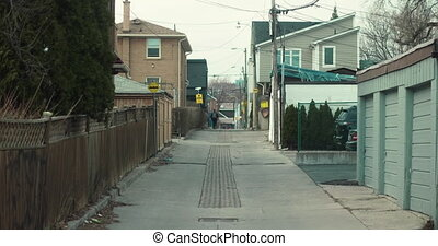 Establishing shot of an unidentifiable kid walking home from...