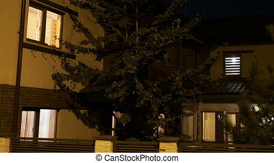 Establishing shot of house automation turning lights on and...