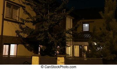 Establishing shot of smart residential house with lights...