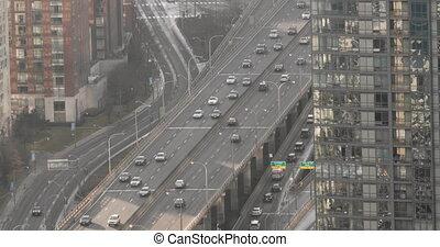 Establishing shot of the Gardiner Expressway in downtown Toronto. Cinema 4K Footage.