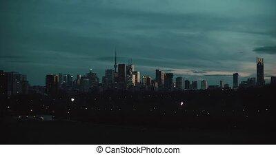 Establishing shot of the Toronto skyline at night.