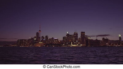 Establishing shot of the Toronto skyline at night.