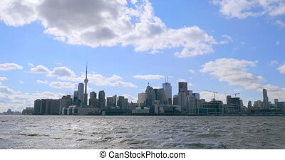Establishing shot of the Toronto skyline during the day.
