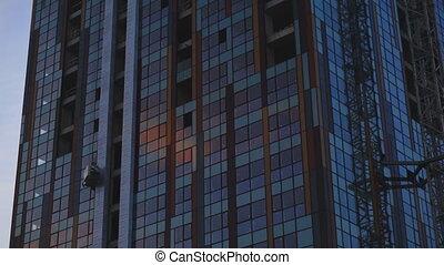 Establishing shot. Scyscrape construction at sunset