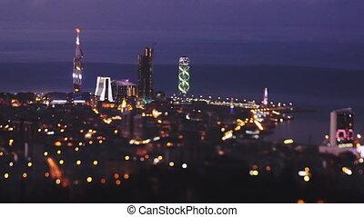 Establishing shot. Sunset cityscape, tilt effect