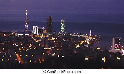 Establishing shot. Sunset cityscape, tilt effect -...