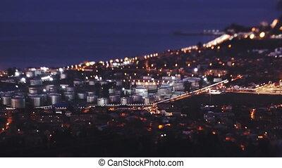 Establishing shot. Sunset industrial cityscape, tilt effect