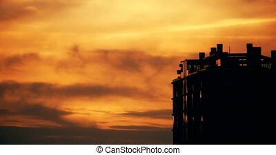 Establishing timelapse shot of an apartment building at sunset in Utrecht.