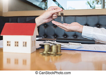 estate agent giving house keys customer sign agreement property for sale, Buying and selling homes concept.