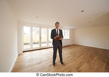 Estate Agent Looking Around Vacant New Property