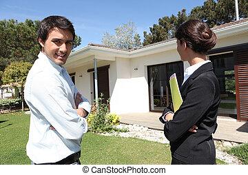 Estate-agent outside property