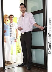 Estate agent showing couple around property